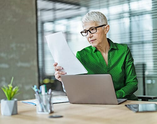Woman reading healthcare regss